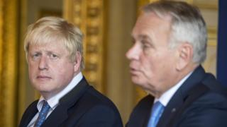French Foreign Minister Jean-Marc Ayrault (R) speaks as British Foreign Secretary Boris Johnson (L) looks on during a joint news conference in Paris on 28 June 2016