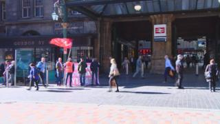 Union members picket outside Glasgow Central Station