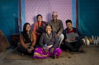 Salina, 21 (left), pictured with her grandmother Batuli Maya Nagarkoti, 72 (centre) and brother Arun Kumar Nagarokoti, 18 (right) and parents (back, left to right) Bimala Nagarkoti, 42 and Aanand Kumar Nagarkoti, 45