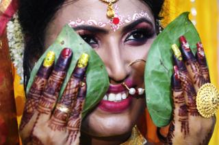 Tista Das, a transgender woman, poses for a photo before her wedding