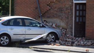 Car crashed into house