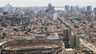 The skyline of central Luanda, Angola, with the 'Estadio da Cidadela' stadium in foreground