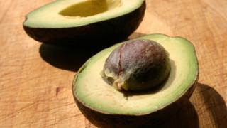 An avocado chopped in half