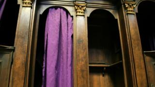 A generic image of a confession booth