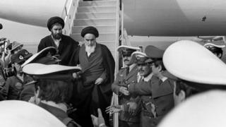 Khomeini arrives in Iran