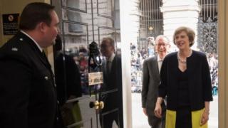 Theresa May and husband Philip enter No 10