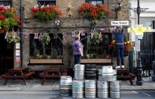 People decorate a pub with Union Flag bunting a day ahead of the royal wedding between Princess Eugenie and Jack Brooksbank in Windsor, Britain, October 11, 2018
