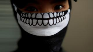 A protester wearing a mask is pictured during an anti-government rally at Causeway Bay, in Hong Kong, China October 6,