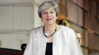 Theresa May arrives for The Sun Military Awards at Banqueting House in London.