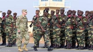Senegal Army General Amadou Kane and US Army General Donald Bolduc dey check soldiers for Dakar military base.