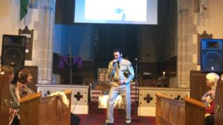 The church invited Elvis impersonator Andy Rogers to lead the service through the music of 'The King'