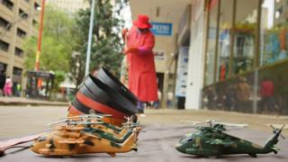 Toy helicopters are sold in the central business district (CBD) of the Zimbabwean capital Harare on November 16, 2017