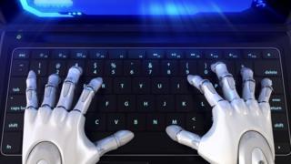 Robot hands on laptop keyboard