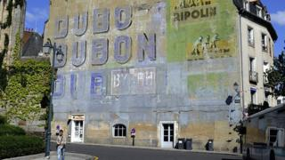 Dubonnet ad painted on side of building
