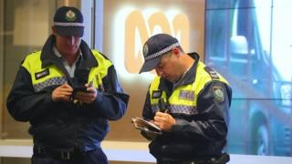 Policemen outside ABC's offices