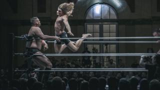 Matt Riddle attacks Walter during a wrestling match