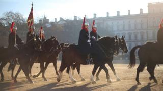 Guards riding to Buckingham Palace