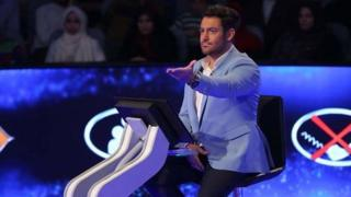 Screenshot from Iranian media showing the host of the show