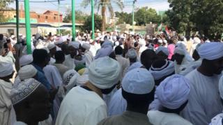 People leave the Sayed Abdelrahman mosque in eastern Omdurman, in the neighbourhood of Wad Nubawi.