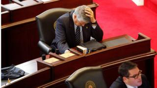 Republican State Senator Norman Sanderson holds his head while fellow Republican Senator Andrew Brock looks during a failed attempt to repeal the controversial HB2 law limiting bathroom access for transgender people in Raleigh, North Carolina