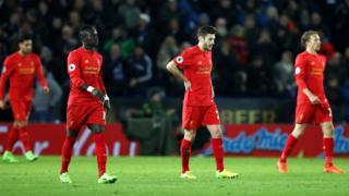 Liverpool players look dejected after losing 3-1 to Leicester City