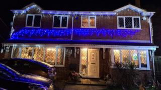 House covered in Christmas decorations during coronavirus outbreak