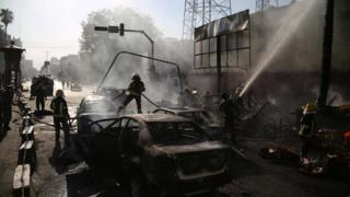 Afghan police inspect the site of a blast in Jalalabad, Afghanistan, July 1, 2018