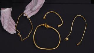 Three gold necklaces and bracelet