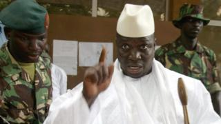 Yahya Jammeh, when president of The Gambia, shows his fingers with ink after casting his vote during the presidential elections 22 September 2006
