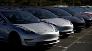 A row of new Tesla Model 3 electric vehicles is seen at a parking lot in Richmond, California, U.S. June 22, 2018