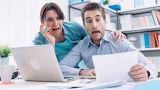 Panicking couple in office