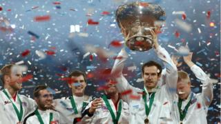Andy Murray holds the Davis Cup after winning the final against Belgium