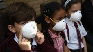 Children wear breathing masks