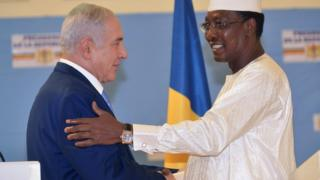 "Chadian President Idriss Deby Itno (R) shakes hands with Israeli Prime Minister Benjamin Netanyahu during a meeting at the presidential palace in N""Djamena on January 20, 2019"
