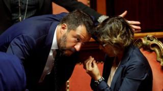 Matteo Salvini (L) and Giulia Bongiorno gesture in the Senate in Rome, Italy, August 5