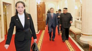 """Kim Yo-jong (L, front), North Korean leader""""s sister and Vice Director of the Propaganda and Agitation Department of the Workers"""" Party of Korea, makes her way before South Korean president Moon Jae-in (C) and North Korean leader Kim Jong-un (R) prior to their meeting at the Labor Party Office in Pyongyang,"""
