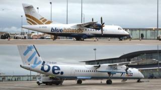 A Blue Islands plane and a Flybe plane.
