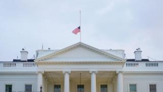 US flag flies at half-mast above the White House after the death of Senator John McCain