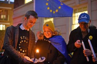 Pro-EU supporters light candles in Smith Square in Westminster, London, ahead of the UK leaving the European Union at 11pm on Friday.
