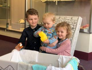 Kids with baby box