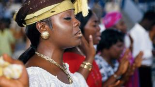 Worshipper in a church in Ghana (archive shot)