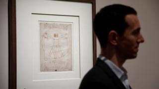 The Vitruvian Man - a drawing by Leonardo da Vinci is pictured during a press visit of the exhibition to commemorate the 500-year anniversary of his death at the Louvre Museum in Paris