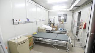 Hospital beds are set up inside the hospital