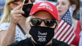 Trump suppoter wearing mask and dark glasses