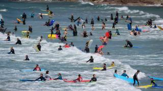 Surfers in Polzeath, Cornwall