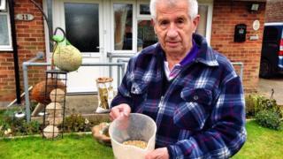 Eric Goleby with bird food