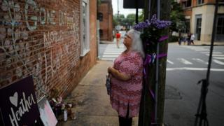 Susan Bro, mother of Heather Heyer, who was killed during the August 2017 white nationalist rally in Charlottesville, stands at the memorial at the site where her daughter was killed in Charlottesville, Virginia, U.S., July 31, 2018.