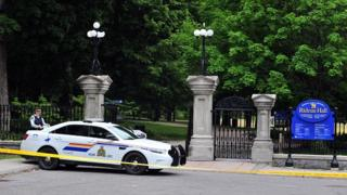 The main entrance to Rideau Hall in Ottawa, with a police car parked outside