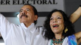 Nicaraguan President Daniel Ortega celebrates with First Lady Rosario Murillo after receiving the credentials in Managua on January 9, 2012, a day before his re-inauguration