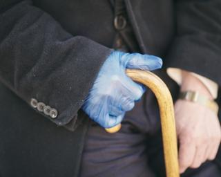 Hand holding walking stick